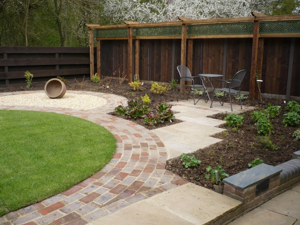 Shaped Brick Pathway and Staggered Indian Sandstone Patio